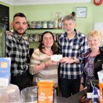 Village Voices present cheque to Helping Hands